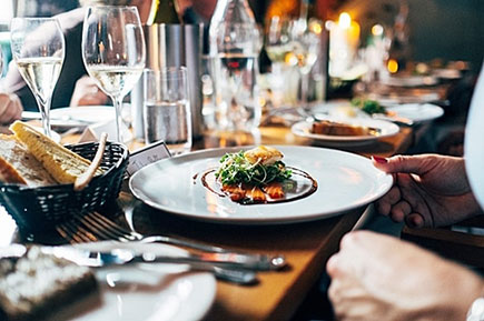 Restaurant plated food and wine glasses