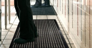 employees standing on a black anti fatigue mat