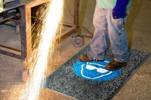 Person standing on Alsco Safety Mat