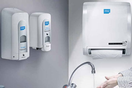 Clean washroom with hygiene dispensers