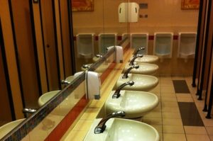 Men's toilet with hand sanitizers