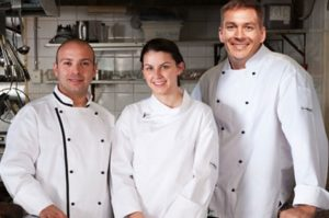 Chefs wearing well sanitised all white uniform