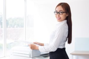 Smiling asian female employee