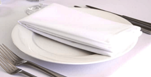 Close up of a clean white linen in a restaurant