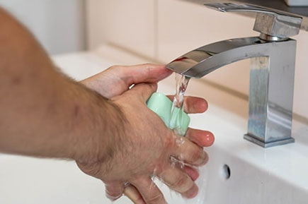 Wash hands with green soap