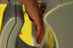Drying hands using hand dryer