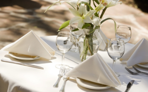 Nice restaurant table setting with clean table linen