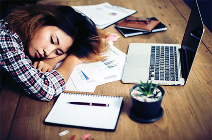 Working woman sleeping at desk