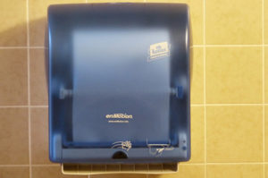 Washroom tissue dispenser