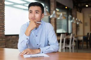 A young man planning on opening a cafe in Singapore.