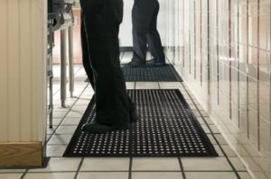 Working while standing using anti-fatigue mats.