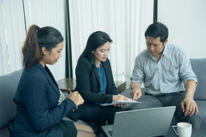 Employees discussing business plan