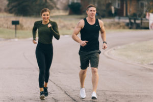 A man and a woman jogging after work.