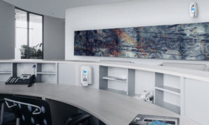 Clean office workplace with hand sanitizer and air freshener