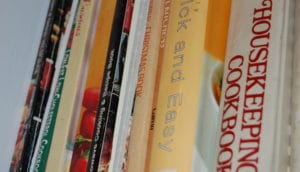 Close up of cookbooks on a shelf