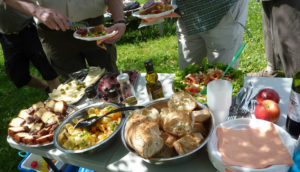 Employees having a picnic day, eating healthy and delicious foods.