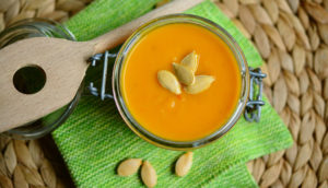 Pumpkin soup with seeds in a jar.