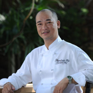 male wearing white chef uniform