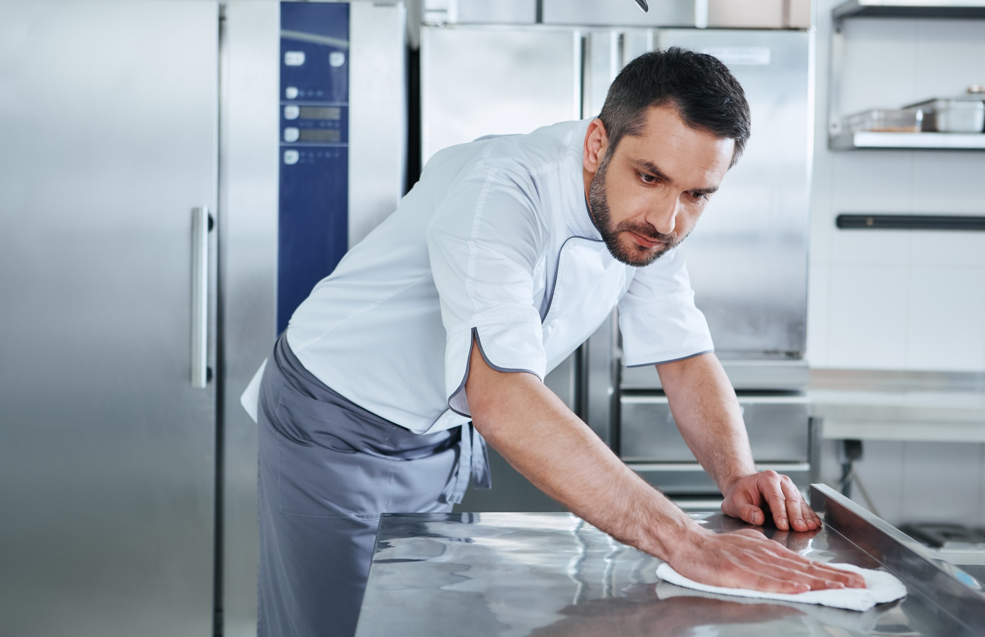 Chef Cleaning Kitchen in uniform